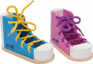 Learn how to tie shoe laces with a wooden threading shoe